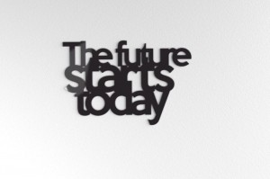The future starts today - napis na ścianę
